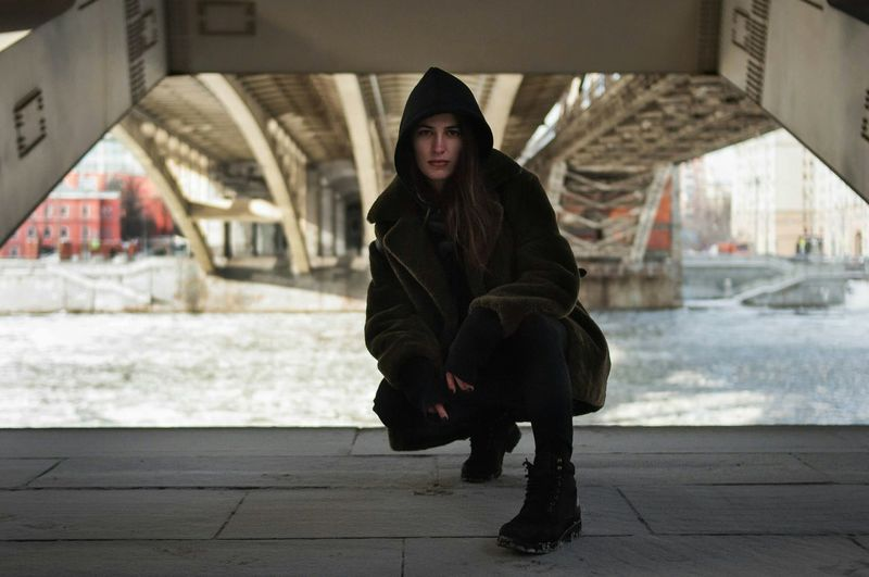 Warm Clothing City Looking At Camera Winter Full Length Hood - Clothing Cold Temperature Outdoors Adult Day Bridge Under The Bridge One Person Beautiful People Beautiful Woman Winter Urban Lifestyle Urbanphotography Urban Fashion Real People City Life Russia Moscow Life Moscow City Urban Style
