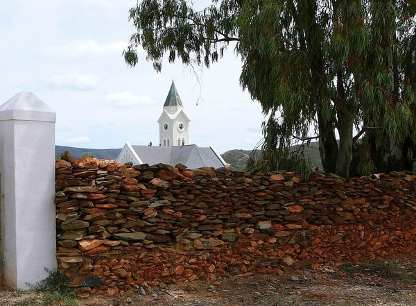 Dutch Reformed Church ~ Africa Architecture Bluegums Building Exterior Built Structure Church Spire Day Dutch Design Nature No People Outdoors Place Of Worship Religion Robertson Sky Stone Material Stone Wall Tree