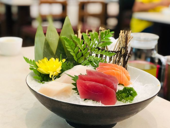 Sashimi Japanese food ready to serve in restaurant Freshness Close-up Flower Flowering Plant Food And Drink Focus On Foreground Food Table Plant Ready-to-eat No People Indoors  Japanese Food Healthy Eating Seafood Business Bowl Nature Still Life Choice