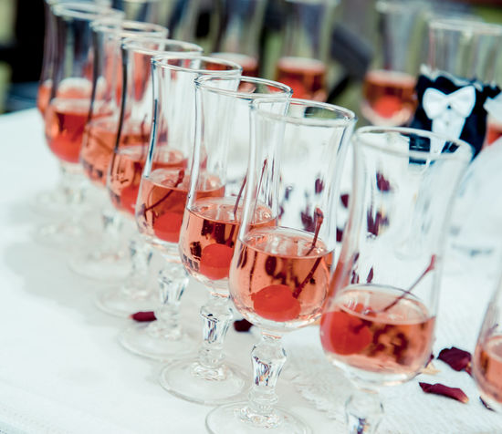 Glass of pink champagne with cherry close-up Champagne Champagne Glasses Drinks Wedding Wedding Reception Alcohol Alcohol Drinks Alcoholic Drink Banquet Table Champagne Flute Close-up Drink Drinking Glass Glass Glassware Indoors  No People Pink Champagne Red Wine Refreshment Restaurant Table Wedding Ceremony Wine Wineglass