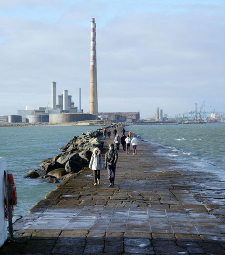 Built Structure Great South Wall Harbour Wall High Tide Out For A Stroll Outdoors Port Power Station Real People Sea Tall Chimneys Walking Water