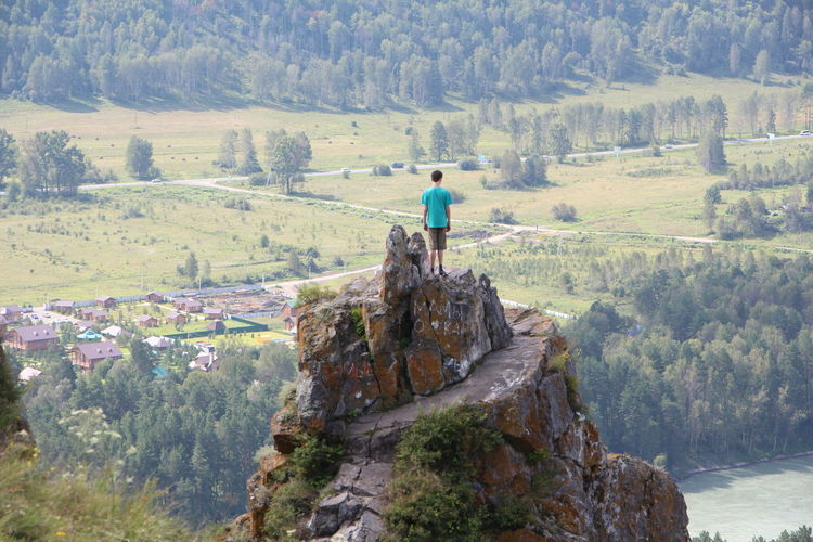 Adventure Altai View Beauty In Nature Boy On The Rock Full Length Idyllic Katu Leisure Activity Looking Down From The R Mountain Rock Rock - Object Sky Vacations People And Places