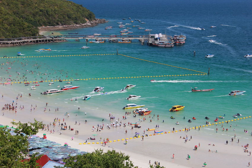 Thailand Travel Aquatic Sport Beach Beauty In Nature Day Enjoyment Fun High Angle View Island Koh Larn Large Group Of People Leisure Activity Lifestyles Men Nature Nautical Vessel Outdoors People Real People Sea Tourism Vacations Water Women
