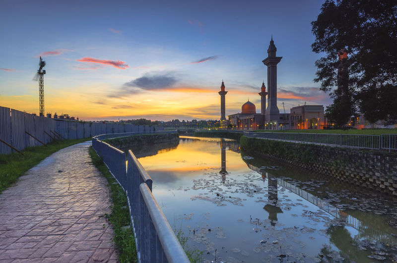 Mosque with sunset background. Eid Mubarak Architecture Building Exterior Built Structure City Cityscape Cloud - Sky Day Dome History Minaret Mosque Muslim Nature No People Outdoors Reflection River Sky Sunset Tourism Travel Travel Destinations Tree Water