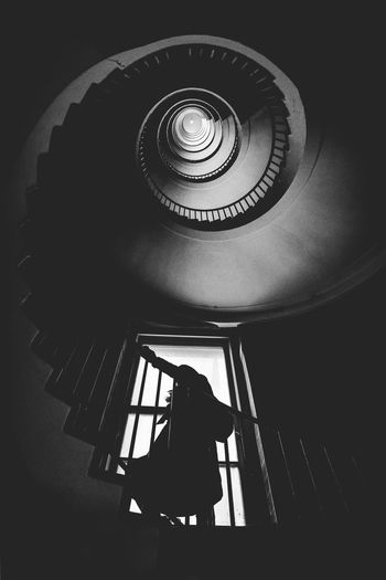 Vertigo! The Creative - 2018 EyeEm Awards The Week on EyeEm Architecture Blackandwhite Bnw Built Structure Day Directly Below Full Length Infinity Leisure Activity Lifestyles Lonley Low Angle View Pattern Real People Rear View Sad Sadness Spiral Staircase Standing Vertigo Vertigofeeling Women