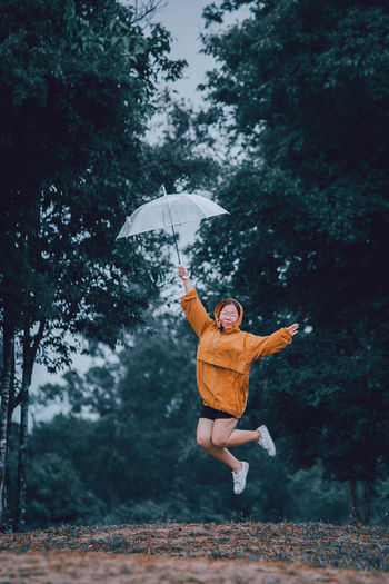 Man jumping in rain