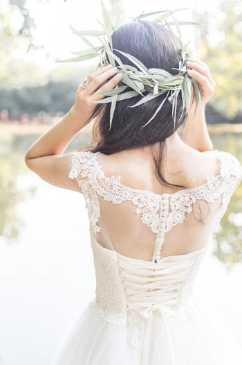 Rear view of woman wearing white dress