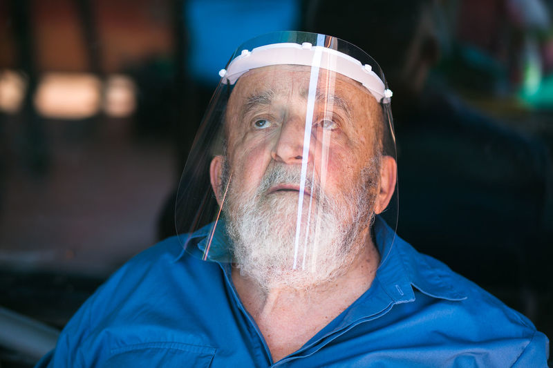 Close-up portrait of man with face shield
