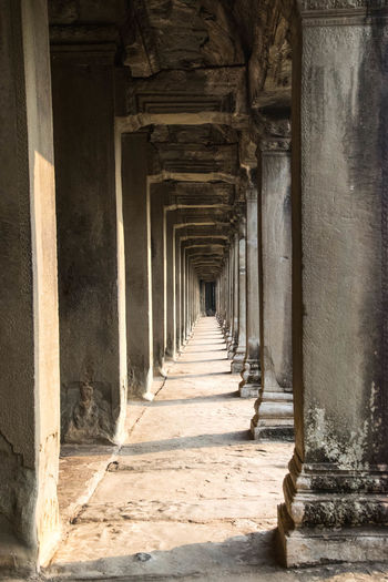 Angkor Angkor Stone Stone Material Light And Shadow Light Architectural Column Underneath Architecture Built Structure Colonnade Arcade Corridor Passage Aged Historic