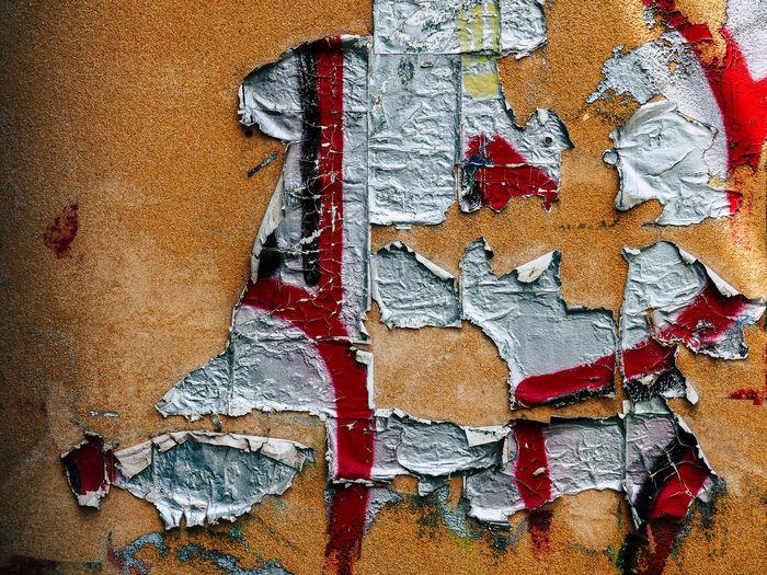Graffiti Peeling On Orange Wall