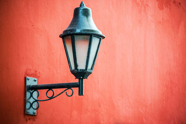 Historic colonial street light set against a vibrant red wall in Cartagena, Colombia Architecture Building Caribbean Cartagena Cartagena De Indias Castle Cityscape Colombia Colombian  Colonial Colonial Architecture Fort Historic Landmark Latin Light Nation Red Spanish Street Style Symbol Travel Walls White