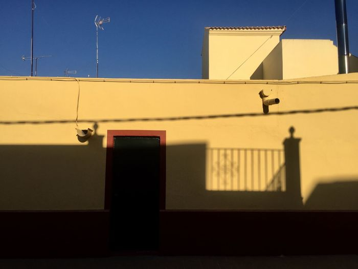 Built Structure Architecture Building Exterior Sky No People Nature Building Outdoors Sunlight Shadow Day Low Angle View Window Clear Sky Yellow Sunset Residential District