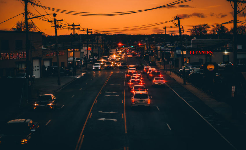 Architecture Building Exterior Built Structure Cable Car City City Life City Street Electricity Pylon Illuminated Land Vehicle Mode Of Transport Night No People Outdoors Road Sky Street Sunset The Way Forward Traffic Traffic Cone Transportation