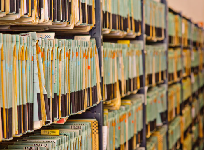 Lot of Files hanging in a row Office Hanging Business Finance And Industry Paperwork File Finance Finance And Economy Row Archive Archives Folder Stack Information Case Many Documents Accounts Organized Storage Cabinet Bookkeeping Accounting Court Justice Administration