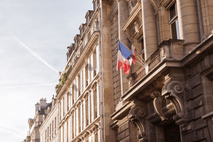 French flag on the exterior of a state building in Paris Architecture Building Building Exterior Built Structure City Day Flag France France 🇫🇷 France🇫🇷 French Low Angle View No People Official Outdoors Paris Patriotism Pole Sky State