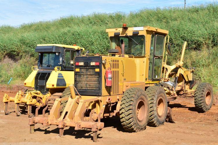 Excavators At Construction Site