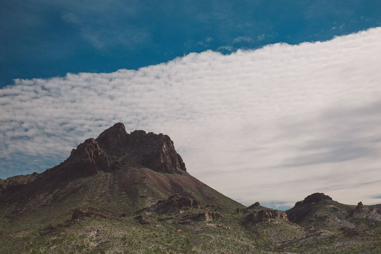 Scenic View Of Mountains Against Cloudy Sky At Route 66