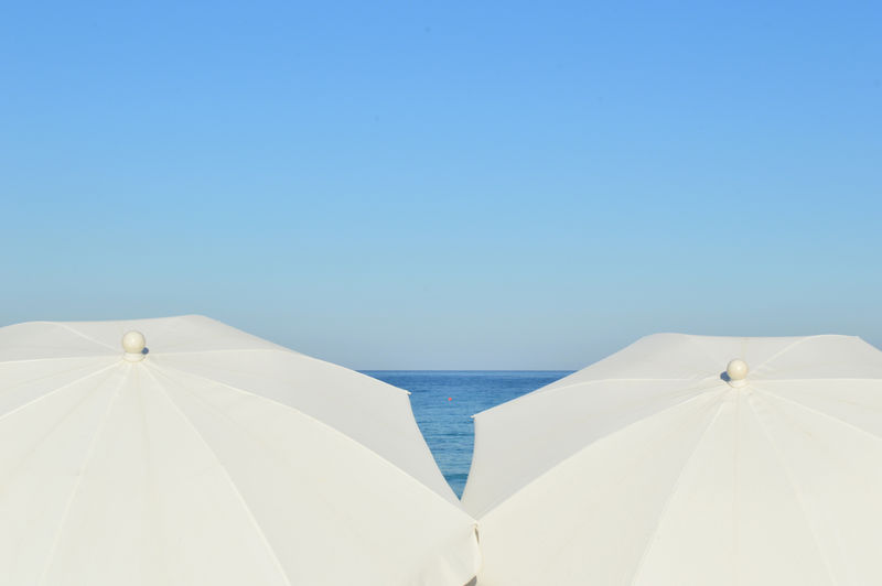View of beach umbrellas and clear blue sky