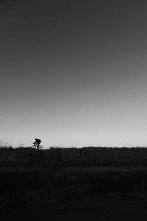 One ► Minimalism Bw Monochrome Blackandwhite Field Copy Space Clear Sky Men Landscape Riding Nature Sky Silhouette