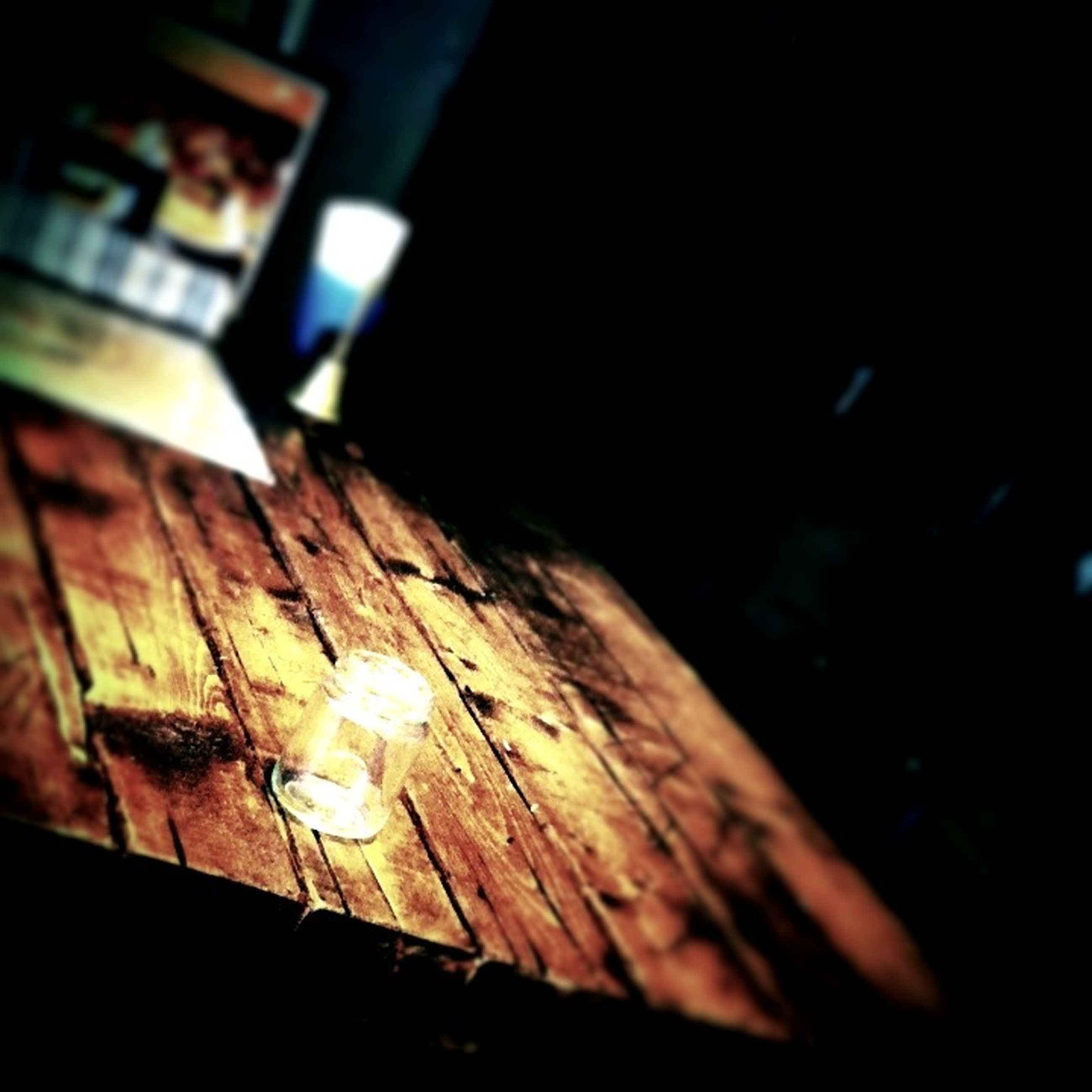 indoors, night, wood - material, selective focus, dark, close-up, wooden, focus on foreground, no people, high angle view, shadow, wood, auto post production filter, sunlight, home interior, house, built structure, illuminated, table