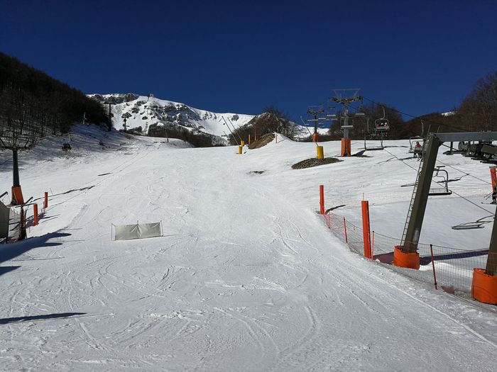 Snow Winter Cold Temperature Mountain Sky White Color Covering Nature Clear Sky Day Beauty In Nature Scenics - Nature Environment Frozen Winter Sport Sport Mountain Range Built Structure Snowcapped Mountain No People Outdoors Ski Resort  Ski Area Chair Lift Roccaraso