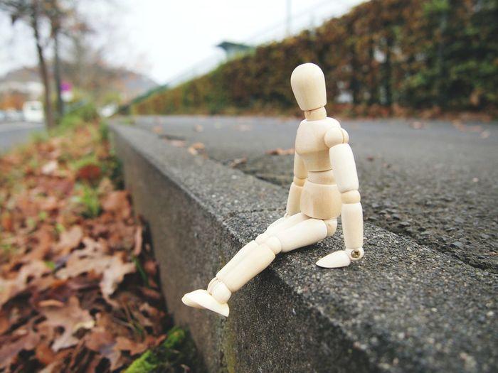 Close-up of figurine on railroad track