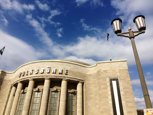 Architecture Built Structure Low Angle View Building Exterior Sky Cloud Cloud - Sky High Section Blue Travel Destinations Outdoors Day Architectural Feature Famous Place No People History Architectural Column Façade Spire  Tourism Battle Of The Cities Street Photography Berlin Volksbühne Germany