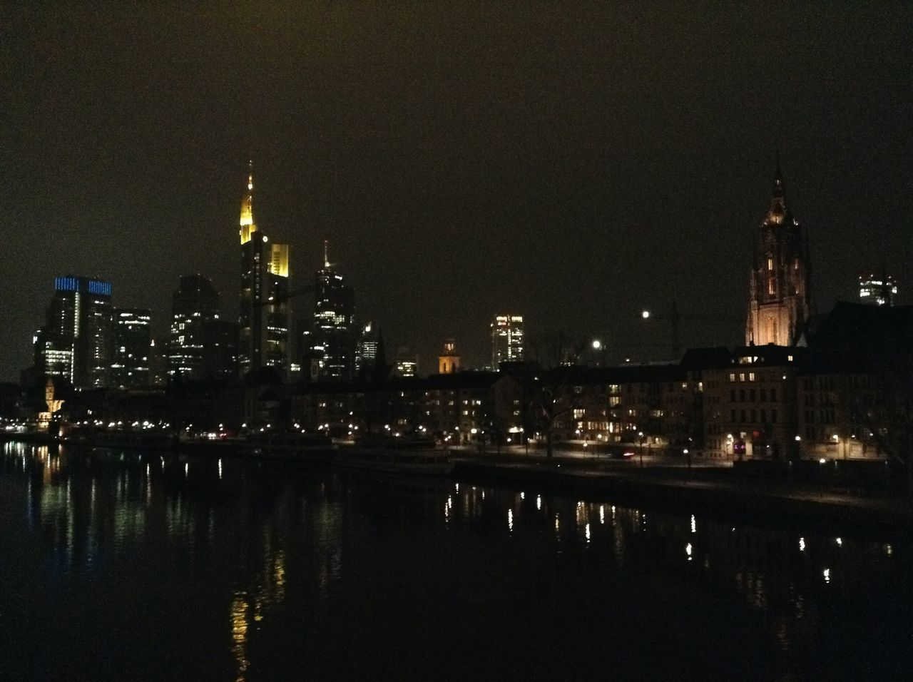 illuminated, architecture, night, building exterior, built structure, reflection, water, city, sky, travel destinations, waterfront, river, no people, skyscraper, cityscape, outdoors, clear sky, nature, urban skyline