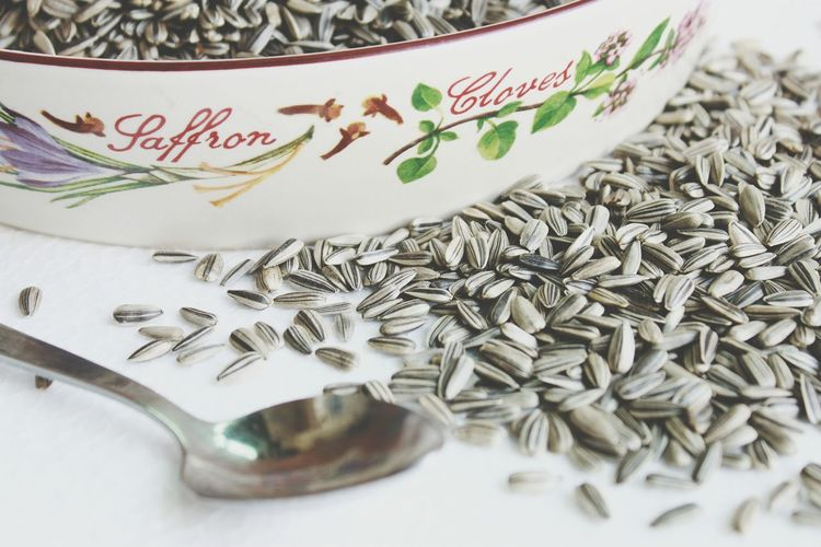 Close-Up Of Sunflower Seeds In Bowl With Spoon