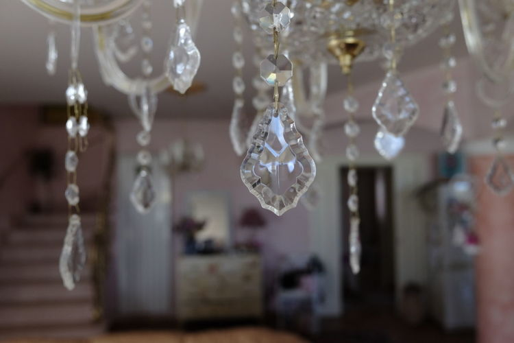 crystal chandelier drops detail Hanging Decoration Selective Focus Indoors  Close-up No People Focus On Foreground Lighting Equipment Crystal Christmas Decoration Christmas Chandelier Glass - Material Celebration Luxury Holiday Home Interior Jewelry Transparent Shape Christmas Ornament Glass Crystal Glassware Silver Colored