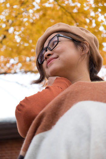 EyeEmNewHere Second Acts Beautiful Woman Close-up Day Eyeglasses  Focus On Foreground Headshot Leisure Activity Lifestyles Low Angle View Nature One Person Outdoors Real People Tree Young Adult Young Women International Women's Day 2019