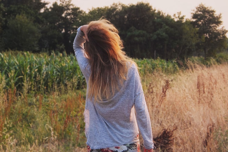 Standing Outdoors Tranquility Girl Hair My Year My View Nature Growth Field Scenics Beauty In Nature Tree Clear Sky No People Architecture