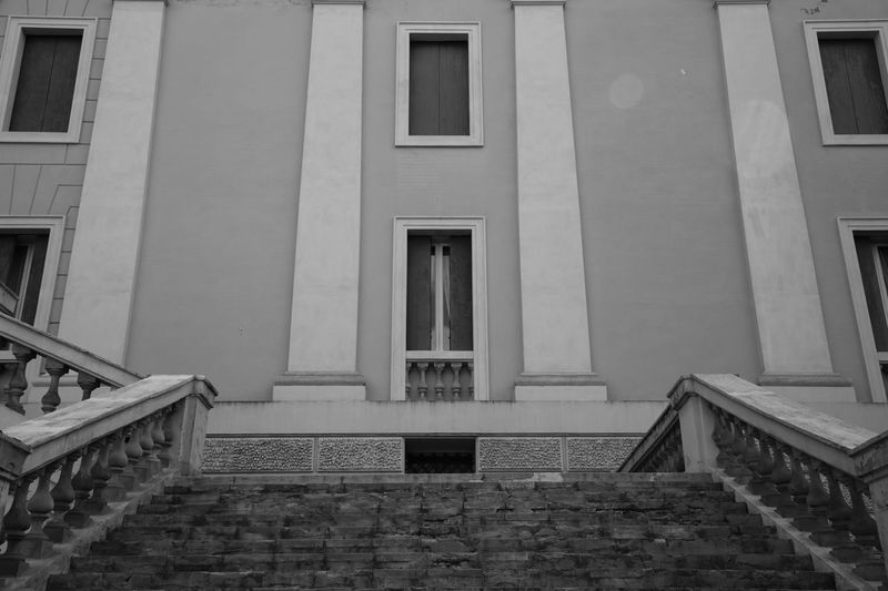 The big stairscase Old Buildings Windows Scenics Architecture_collection Blackandwhite Moments EyeEm Best Edits EyeEmBestPics Italy Secret Places High Angle View Canon5Dmk3 Inspirational Architecture Built Structure Building Exterior Staircase Building Window Day No People Steps And Staircases Residential District Entrance Outdoors House Door
