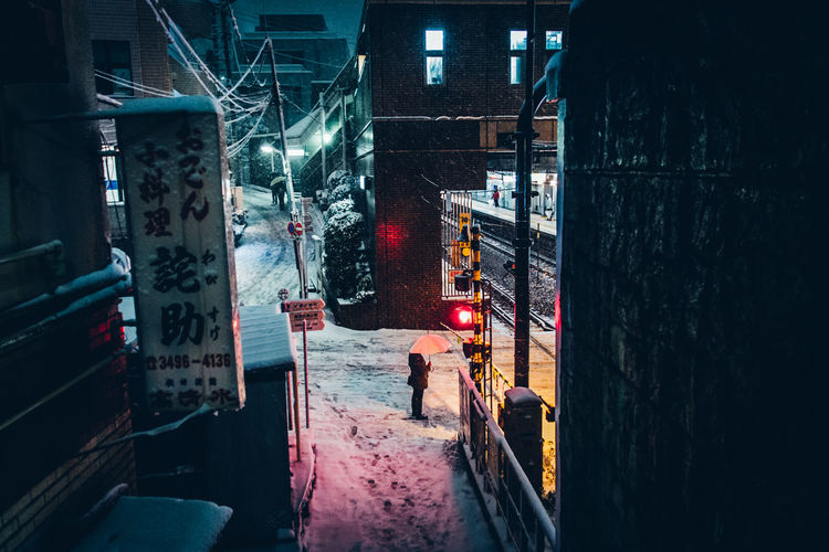 Shibuyascapes Minimalism Japan Japan Lovers Man Tokyo Urban Exploration Weather Architecture Atmospheric Mood Building Exterior Built Structure City Cold Cold Temperature Illuminated Night Night View No People Outdoors Snow Snowing Snowy Snowy Day Street Umbrella Winter Shades Of Winter Mobility In Mega Cities Colour Your Horizn Stories From The City Inner Power HUAWEI Photo Award: After Dark