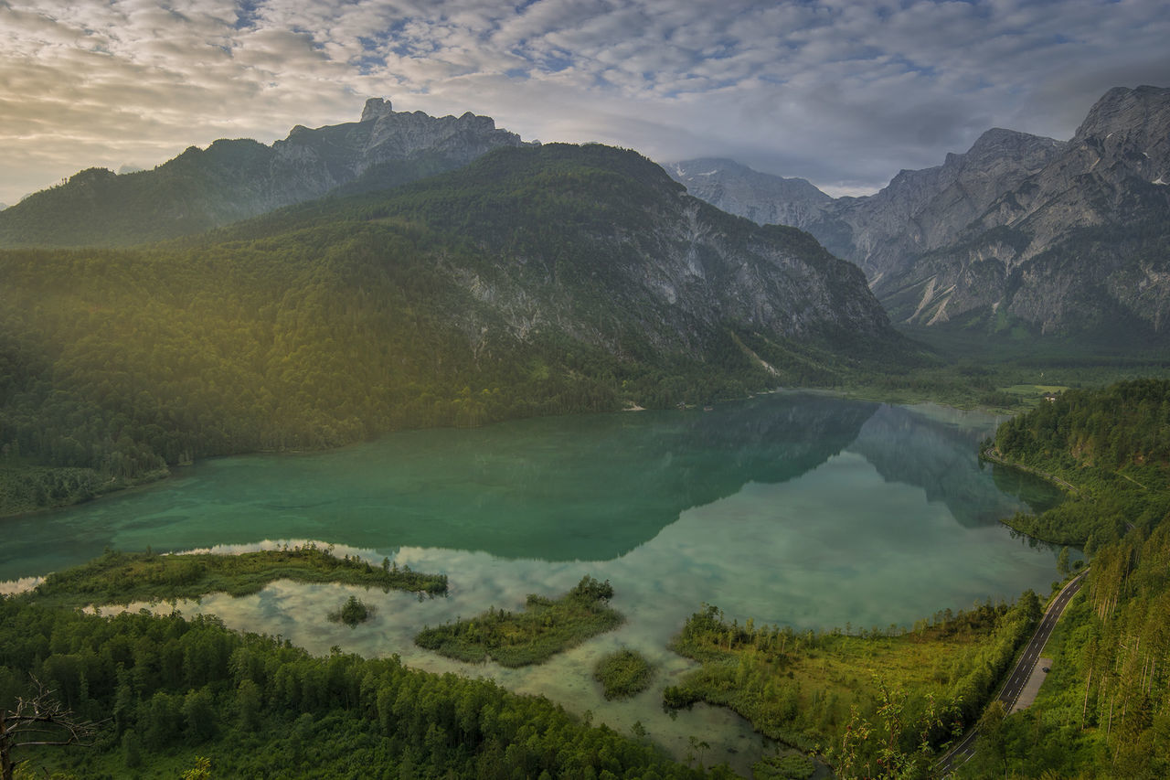 mountain, scenics - nature, beauty in nature, water, tranquil scene, tranquility, mountain range, cloud - sky, nature, non-urban scene, sky, environment, idyllic, plant, lake, landscape, no people, green color, day, outdoors, formation