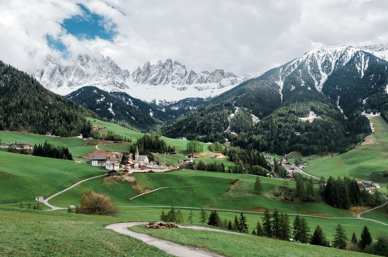 Scenic view of landscape and mountains against sky in dolomiti mountains.