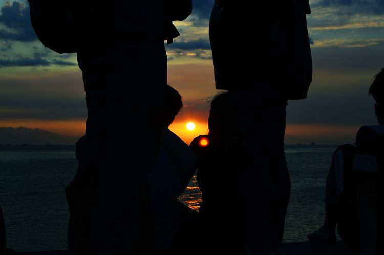 Sunset Watching. Who said we can not sunset watch while in the middle of a metropolitan? Eyeem Philippines Philippines Nature Family This Is Family Relationship Love Water Sunset Silhouette Sky Close-up Summer Exploratorium Visual Creativity The Street Photographer - 2018 EyeEm Awards The Portraitist - 2018 EyeEm Awards The Creative - 2018 EyeEm Awards The Photojournalist - 2018 EyeEm Awards