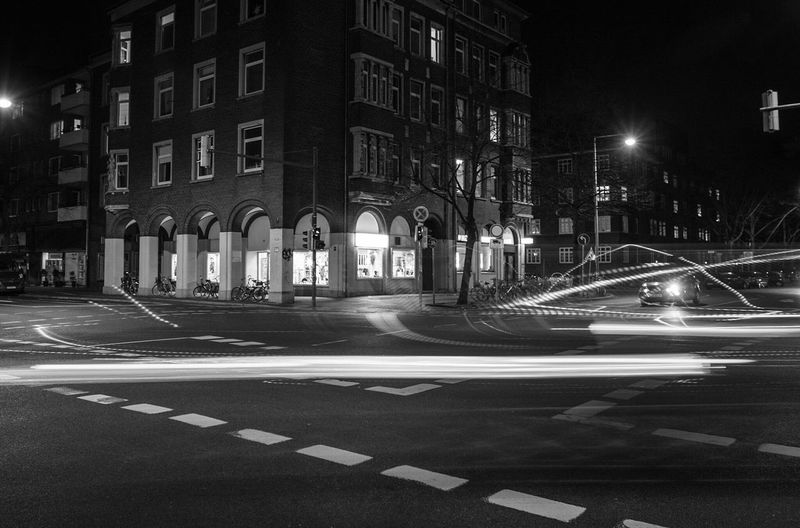 ~ ✴🎈 ~ City Architecture Building Exterior Street Transportation Travel Destinations Built Structure No People Outdoors Night Light And Shadow Getting Inspired Light Trail Illuminated Motion Long Exposure Monochrome Black & White Street Photography Blackandwhite Shadows & Lights Black And White Architecture_collection Driving My Year My View