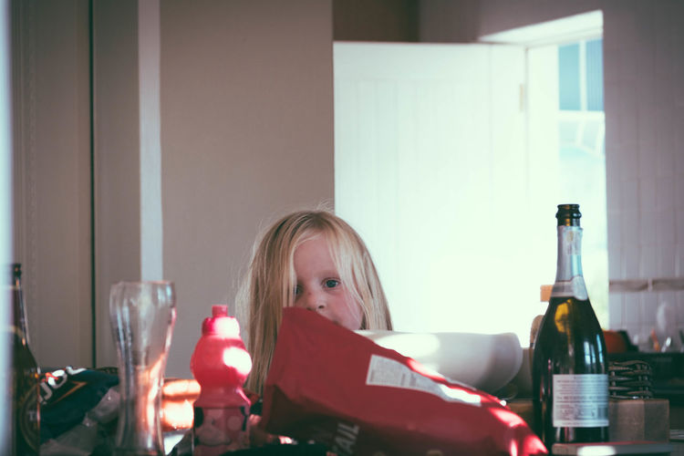 "Cheeky Niece looking for ""chippies"" Blonde Girl Curiosity Focus On Foreground Headshot Home Kitchen Lifestyles Little Girl Niece  Peeking Sunday The Following Home Is Where The Art Is"