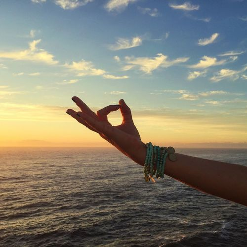 Hand sign and beautiful nature Beach Beautiul Beauty In Nature Cloud - Sky Clouds Enjoying Life Enjoying The Sun Hand Horizon Over Water Idyllic Nature Nature Orange Color Person Sea Sign Sky Sun Sunset Tranquil Scene Tranquility Travel Traveling Vacation Water