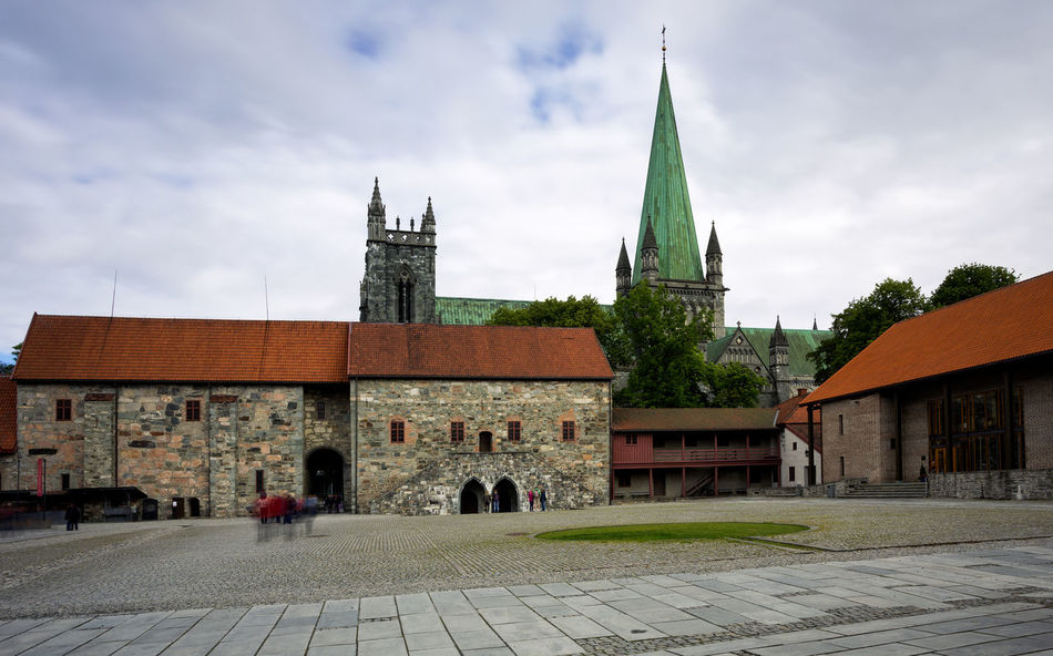 Urban landscape in Norway,Trondheim Cathedral Cityscape Nidaros Cathedral Nidarosdomen Norway Travel Trondheim Architecture Belief Building Building Exterior Built Structure Cathedrale City Cityscape Photography Cloud - Sky Gothic Style History Incidental People Nature Nidaros Nidaros Cathedral Norway Nature Outdoors Place Of Worship Religion Sky Spire  Spirituality Street Tower Travel Destinations