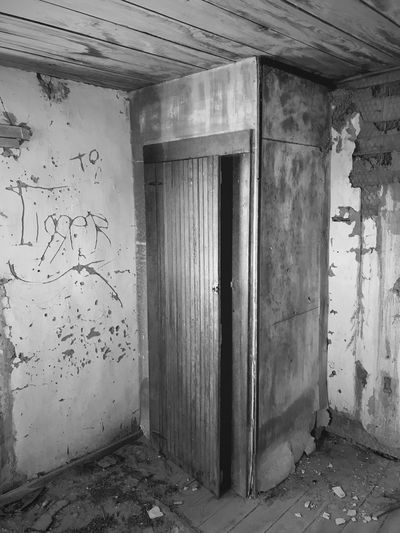 """""""Once Upon A Time In Cedarvale No. 8"""" Time machine. New Mexico Photography New Mexico Abandoned House Abandoned & Derelict Abandoned Buildings Blackandwhite Photography Black & White Black And White Blackandwhite Time Machine Mystery Closet Abandoned Door Indoors  No People Built Structure Day"""