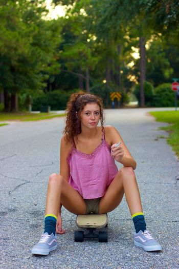 Got a light? Landyachtz Skateboarding Smoking Cigarette  EyeEm Selects One Person Full Length Girls Child Sitting Front View Hairstyle Portrait Looking At Camera Women Leisure Activity Lifestyles Hair Casual Clothing Plant Street Day Transportation Females Teenager