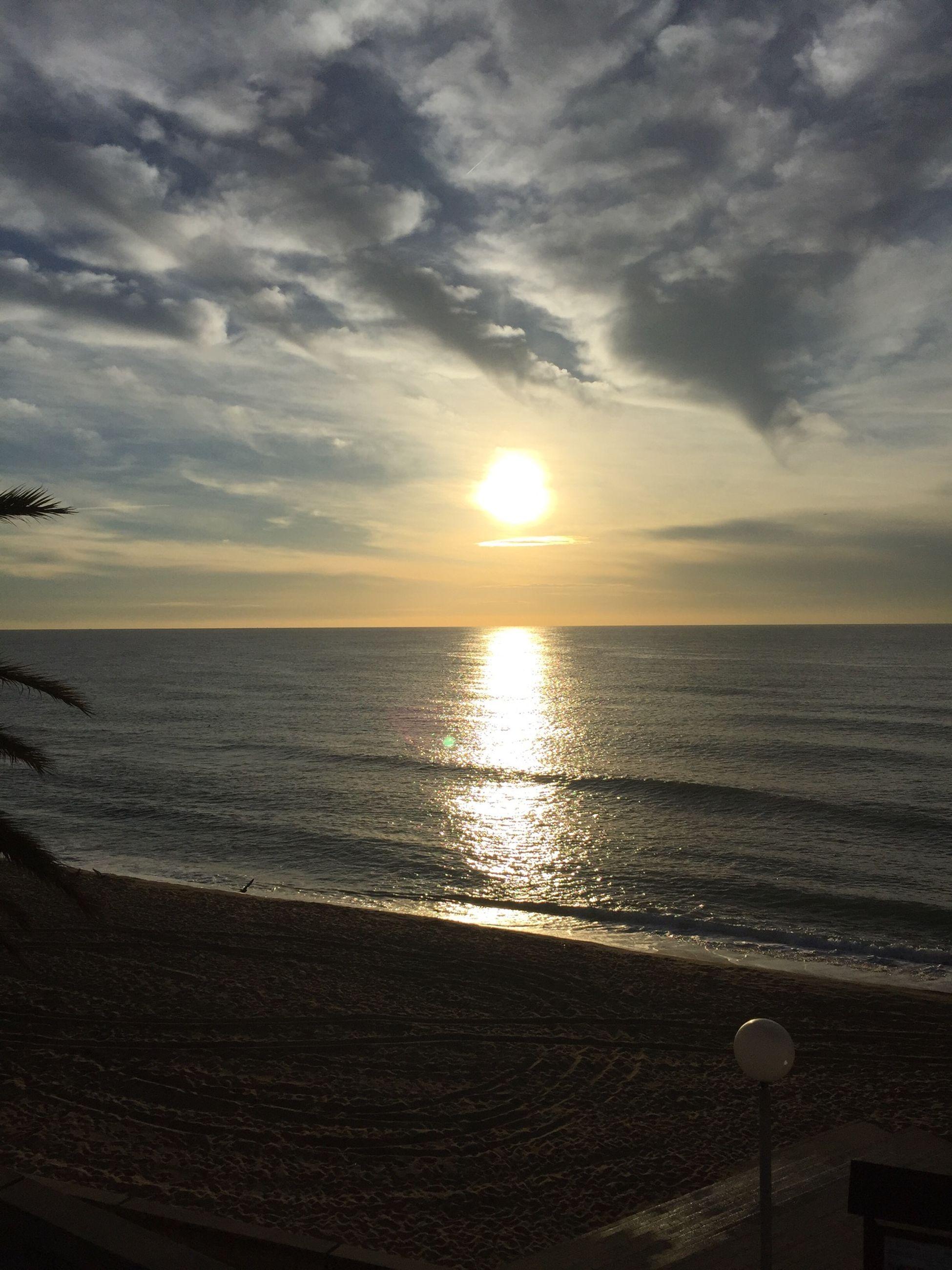 horizon over water, sea, water, beach, sunset, sky, scenics, tranquil scene, beauty in nature, sun, tranquility, shore, cloud - sky, idyllic, nature, reflection, cloud, sunlight, cloudy, seascape