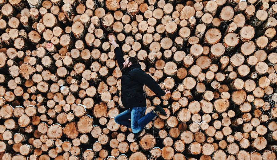 Man of the Woods EyeEm EyeEm Masterclass EyeEm Best Shots - Nature EyeEm Gallery Wood - Material Wood Forest One Person Jumping EyeEm Nature Lover EyeEm Best Shots ShotOnIphone Week On Eyeem The Week on EyeEm Firewood Stack Log Timber Lumber Industry Woodpile Deforestation Wood - Material Large Group Of Objects Lifestyles Nature