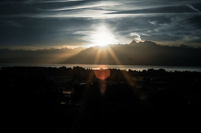 Home Alps Beauty In Nature Cloud - Sky Day Idyllic Lake View Landscape No People Outdoors Scenics Silhouette Sky Sun Sunlight Sunrise Switzerland Tranquil Scene Water