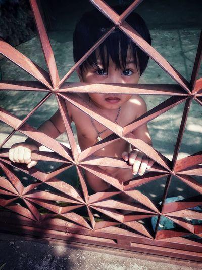 Small children in a bare body behind a steel cage prevented them from leaving. Close-up Geometric Shape Triangle Shape Hexagon Rectangle Pyramid Shape Ancient Egyptian Culture Geometry Circular Pyramid Honeycomb High Voltage Sign Bunting Skylight Square Shape Triangle Crisscross Pattern Architectural Detail Star Shape Metal Grate Design Door Knocker Shape