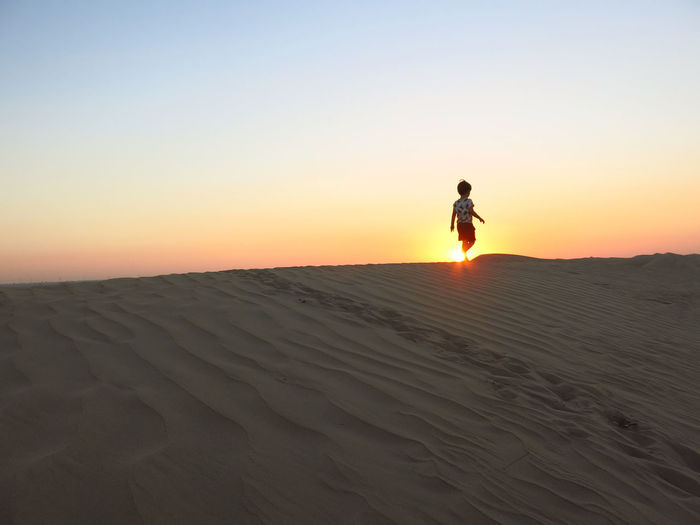 Walking on sunshine in Dubai desert Beach Beauty In Nature Clear Sky Nature One Person Real People Sand Scenics Sunset Toddler  Walking On Sunshine