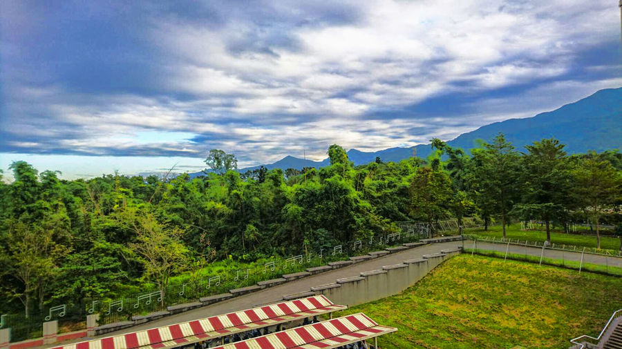 Beauty In Nature Cloud - Sky Day Green Color Growth Mountain Nature No People Outdoors Scenics Sky The Way Forward Tree Winding Road