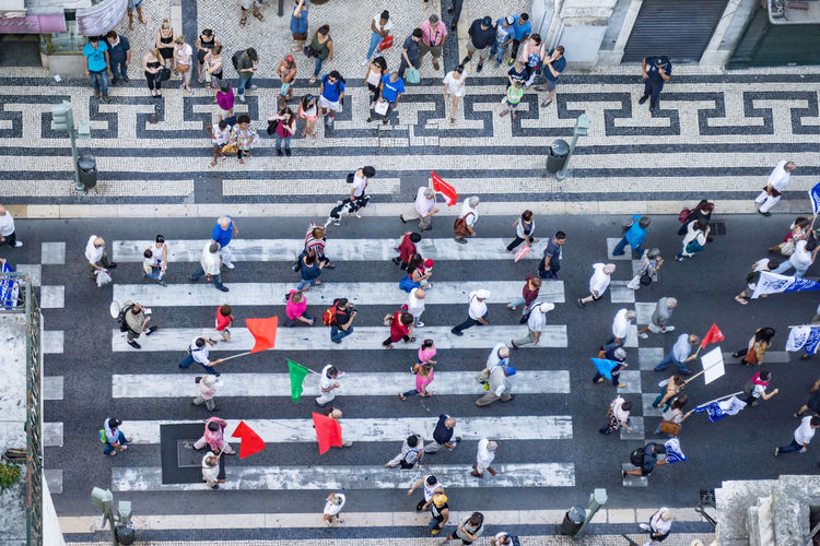 Top down view of marching demonstrators, Lisbon, Portugal. Portugal Adult Adults Only Banners City Crossing Crowd Day Demonstration Flags Geometric Pattern High Angle View Large Group Of People Lisbon Men Outdoors People Street Travel Destinations Women